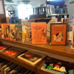 a shelf of halloween books for kids at thomas beaver free library
